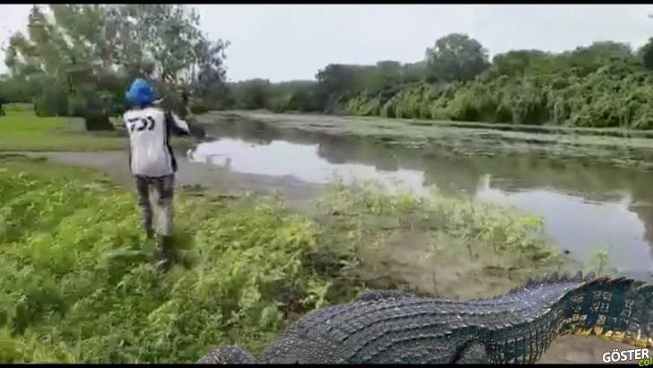 Nehirde büyük balık tutayım derken karşılaştığı dev timsaha av olmaktan son anda kurtulan adam
